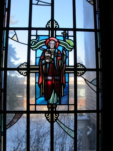 John the Baptist.  Stained glass, Emmaus Hall.