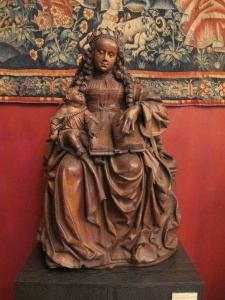 Virgin with Child, reading. 1543.  Cluny Museum, Paris.